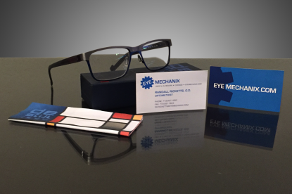 My new De Stijl eyewear bought from EyeMechanix.com (where I developed the logo and branding on a freelance projextg in 2014) ALso displayed, Dr. Rickett's business card I designed.
